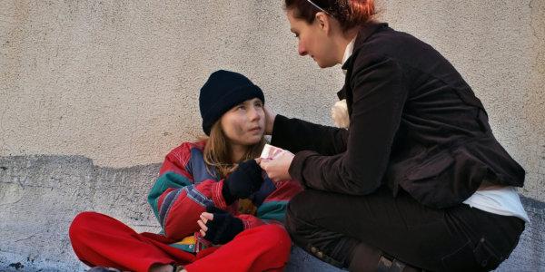woman helping kids