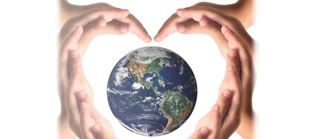 heart shaped hand and a globe